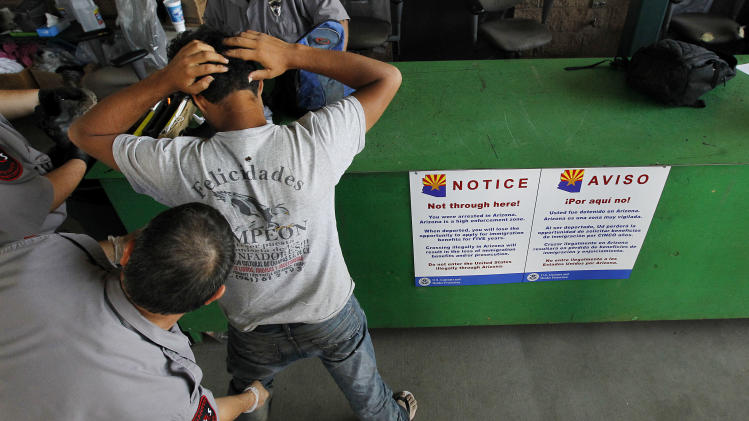 A newly arrived illegal immigrant, caught in Arizona by the U.S. Border Patrol, is initially processed at Tucson Sector U.S. Border Patrol Headquarters Thursday, Aug. 9, 2012, in Tucson, Ariz.  He is one of the nearly 100 border crossers processed on this day, eventually split into groups, according to their previous record with the Border Patrol, before heading off to jail or being returned to Mexico.(AP Photo/Ross D. Franklin)