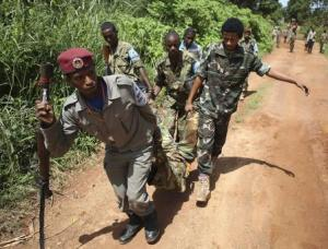 A Seleka fighter injured by a mortar shell fired by French soldiers is carried by his comrades in Bambari