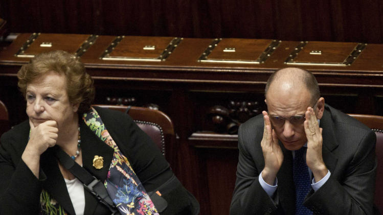 Italian Premier Enrico Letta, right, and Justice Minister Annamaria Cancellieri wait ahead of a confidence vote at the Italian Lower Chamber of Parliament, in Rome, Wednesday, Nov. 20, 2013. Italy's justice minister has denied intervening to free a family friend from jail in an address to lawmakers as she faced a confidence vote. Cancellieri has been under pressure to resign following revelations that, while minister, she called the friend's companion to express sympathy after her arrest for alleged false accounting. Cancellieri told Parliament ahead of the Wednesday confidence vote that she regretted the personal phone call, but insisted that she had shown no professional favoritism. She has the support Premier Enrico Letta, who sought to ensure center-left lawmakers' support Cancellieri by linking the confidence vote to the survival of his government. (AP Photo/Mauro Scrobogna, Lapresse) ITALY OUT