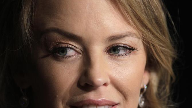 Actress Kylie Minogue listens during a press conference for Holy Motors at the 65th international film festival, in Cannes, southern France, Wednesday, May 23, 2012. (AP Photo/Francois Mori)