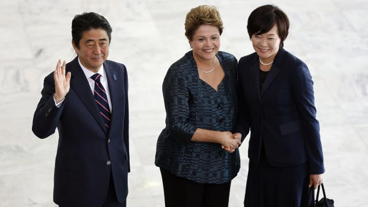 Brazil's President Rousseff shakes hands with Akie Abe, the wife of Japan's PM Shinzo Abe, before a meeting at the Planalto Palace in Brasilia