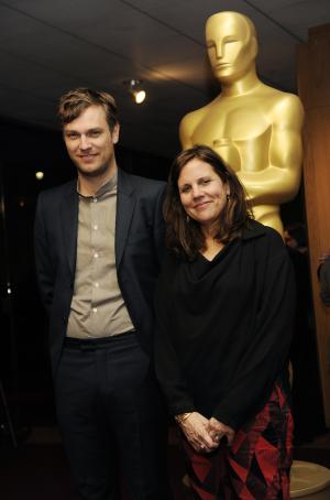 "Zachary Heinzerling, left, writer/director of the Oscar-nominated documentary film ""Cutie and the Boxer,"" poses with the film's producer Lydia Dean Pilcher at a reception featuring the Oscar nominees in the Documentary Feature and Documentary Short Subject categories on Wednesday, Feb. 26, 2014, in Beverly Hills, Calif. The Oscars will be held on Sunday at the Dolby Theatre in Los Angeles. (Photo by Chris Pizzello/Invision/AP)"