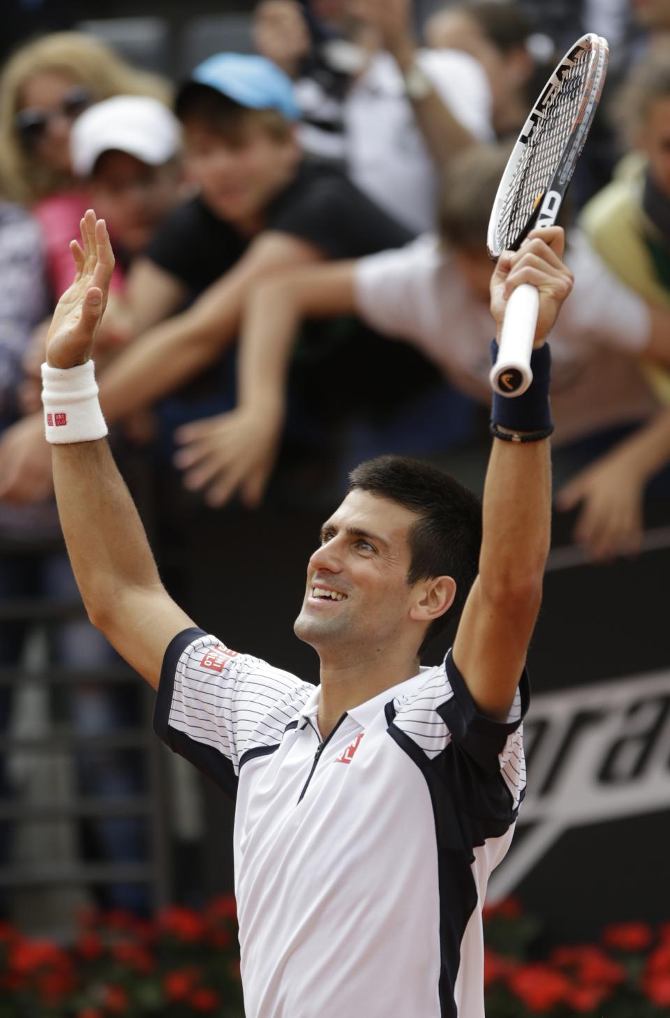 Serbia's Novak Djokovic celebrates after defeating Ukraine's Alexandr Dolgopolov during their match at the Italian Open tennis tournament in Rome, Thursday, May 16, 2013. Djokovic beat Dolgopolov 6-1, 6-4 and advanced to the quarterfinals. (AP Photo/Andrew Medichini)