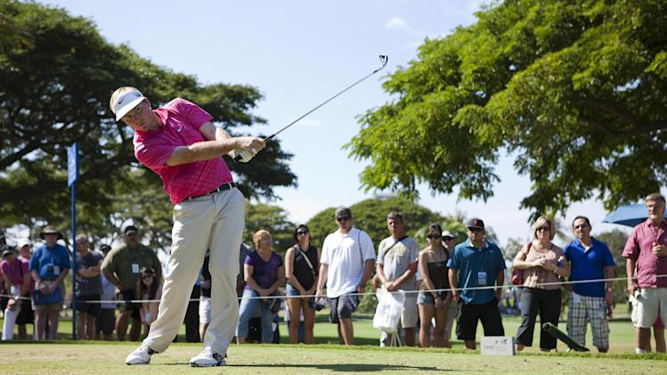 Russell Henley drives off the fourth tee during the final round of the Sony Open golf tournament, Sunday, Jan. 13, 2013, in Honolulu.  (AP Photo/Marco Garcia)