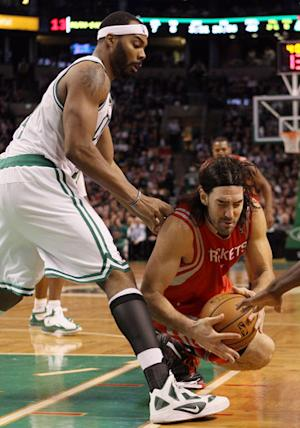 Celtics awaken in time to beat Rockets 97-92 in OT