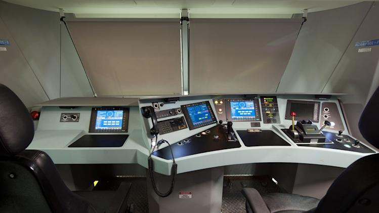 This undated handout photo provided by Amtrak shows a mock-up of the interior of an electric Amtrak locomotive scheduled for delivery in 2013. Amtrak's fiscal 2012 operating loss was the lowest in nearly 38 years, which is a sign of progress, Joseph Boardman, the railroad's president and CEO, said Thursday. The $361 million loss for the year ending Sept. 30 was down 19 percent from the previous year. The last time Amtrak losses were less was 1975.  (AP Photo/Amtrak)