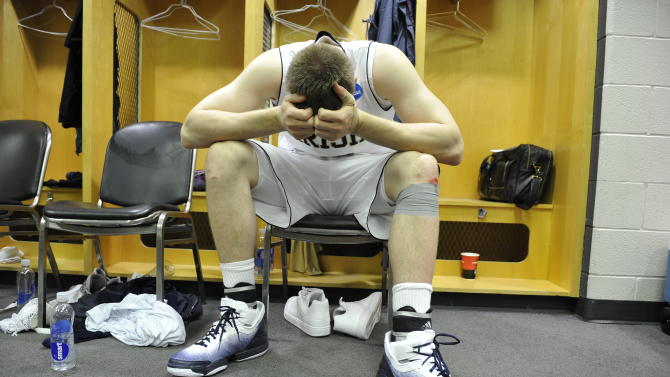 Notre Dame forward Jack Cooley looks down in the locker room after a third-round NCAA Southwest Regional tournament college basketball game against the Florida State in Chicago, Sunday, March 20, 2011. Florida State won 71-57. (AP Photo/Jim Prisching)