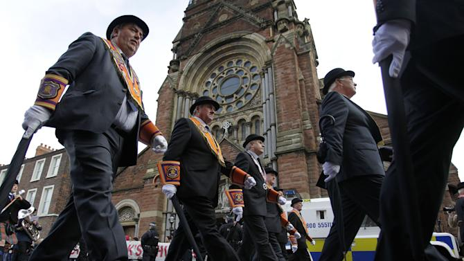 Orange order members parade past St Patrick's Roman Catholic church in Belfast city centre, Northern Ireland, Saturday, Sept. 29, 2012.  Thousands of people are taking part in commemorations in Belfast to mark one of the most significant dates in unionist history. The six-mile march from central Belfast to Stormont marks the 100th anniversary of the Ulster Covenant, to oppose Home Rule for Ireland in 1912.  (AP Photo/Peter Morrison)