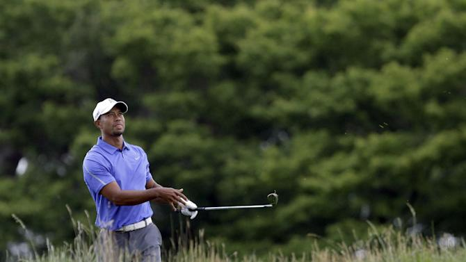 Tiger Woods watches his shot on the first hole during the first round of the U.S. Open golf tournament at Merion Golf Club, Thursday, June 13, 2013, in Ardmore, Pa. (AP Photo/Gene J. Puskar)