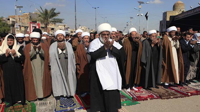 Followers of Shiite cleric Muqtada al-Sadr pray during Friday prayers in the Shiite stronghold of Sadr City in Baghdad, Iraq, Friday, Feb. 1, 2013. (AP Photo/ Karim Kadim)
