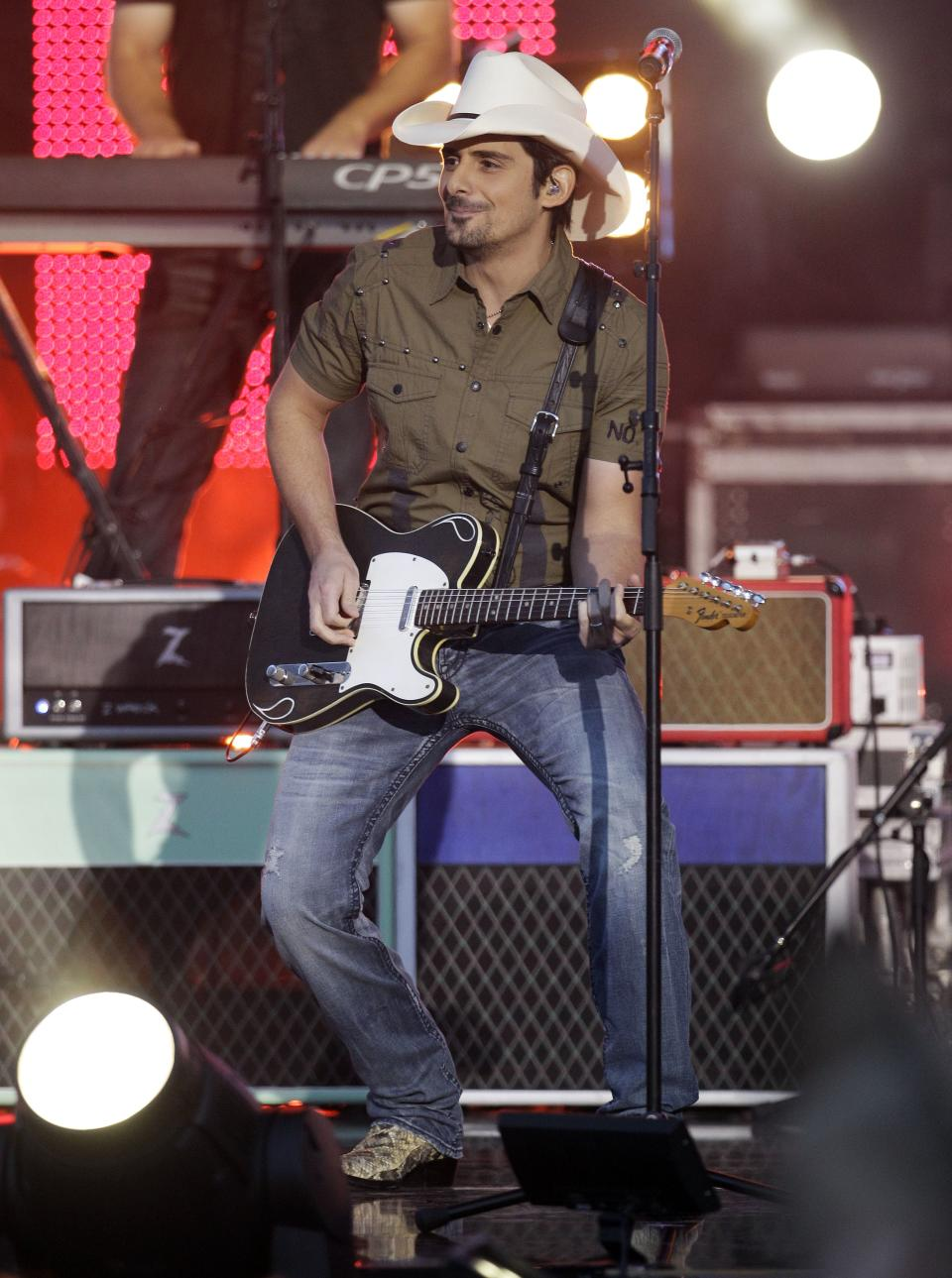 Brad Paisley performs on an outdoor stage during the CMT Music Awards show on Wednesday, June 6, 2012, in Nashville, Tenn. (AP Photo/Mark Humphrey)