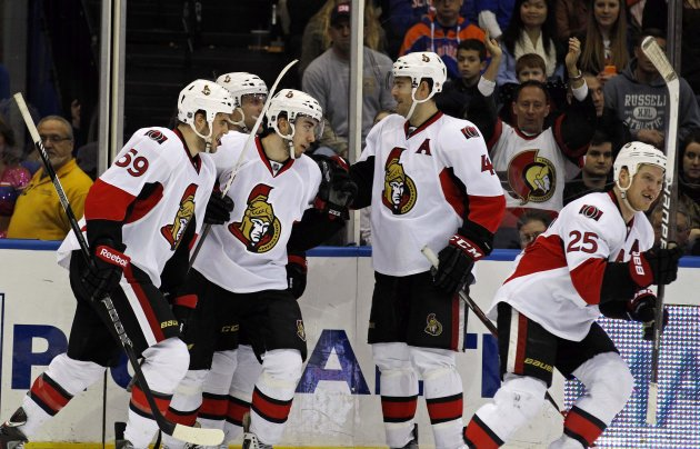 Ottawa Senators center Zibanejad is congratulated by teammates after scoring against the New York Islanders in second period of their NHL hockey game in Uniondale