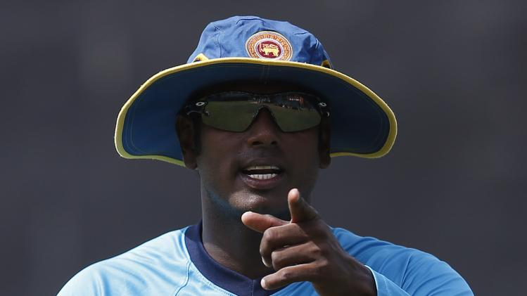 Sri Lanka's captain Mathews talks to a team official during a practice session ahead of their second test cricket match against South Africa in Colombo