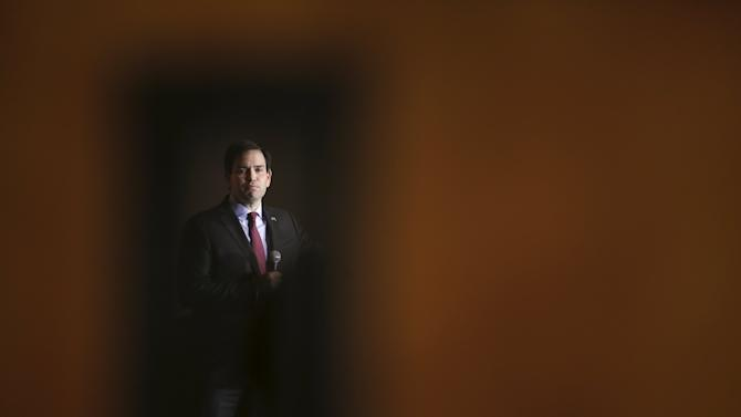 U.S. Republican presidential candidate Marco Rubio is pictured though a door as he speaks at a campaign event in Simpsonville
