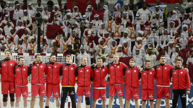 Poland 's team players sing their national anthem before their semi-final match against Qatar at the 24th Men's Handball World Championship in Doha