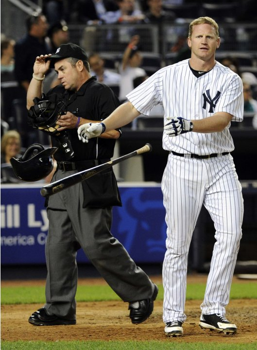 New York Yankees' Overbay tosses his bat and helmet after striking out during a MLB inter-league baseball game double-header against Los Angeles Dodgers in New York