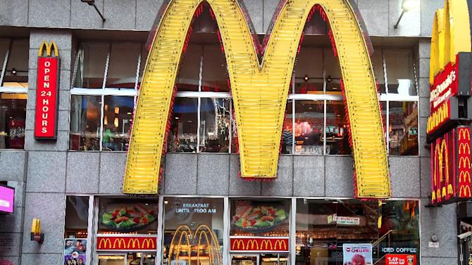 In this May 6, 2012, photo, people walk around a McDonald's restaurant in New York's Time Square. McDonald's Corp. said Tuesday, May 8, that a key revenue figure rose in April as strength in the U.S. and U.K. helped offset weakness in Japan. But results missed analyst expectations and McDonald's shares fell 2 percent in premarket trading. The world's largest hamburger chain says global sales rose 3.3 percent at stores open at least 13 months. (AP Photo/CX Matiash)