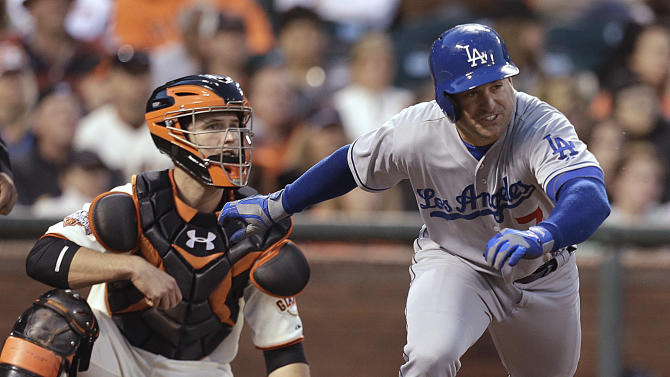 Los Angeles Dodgers' Nick Punto, right, runs to first base as San Francisco Giants catcher Buster Posey watches after Punto hit an RBI double off Giants' Jean Machi in the fifth inning of a baseball game Saturday, May 4, 2013, in San Francisco. (AP Photo/Ben Margot)