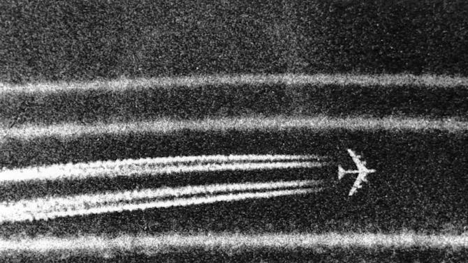 FILE - B52 high altitude bombers leave condensation trails while passing the town of Cai Lay in the Mekong Delta on Sept. 29, 1972, moments after unleashing bombs on a suspected enemy positions. (AP Photo/Nick Ut, File)