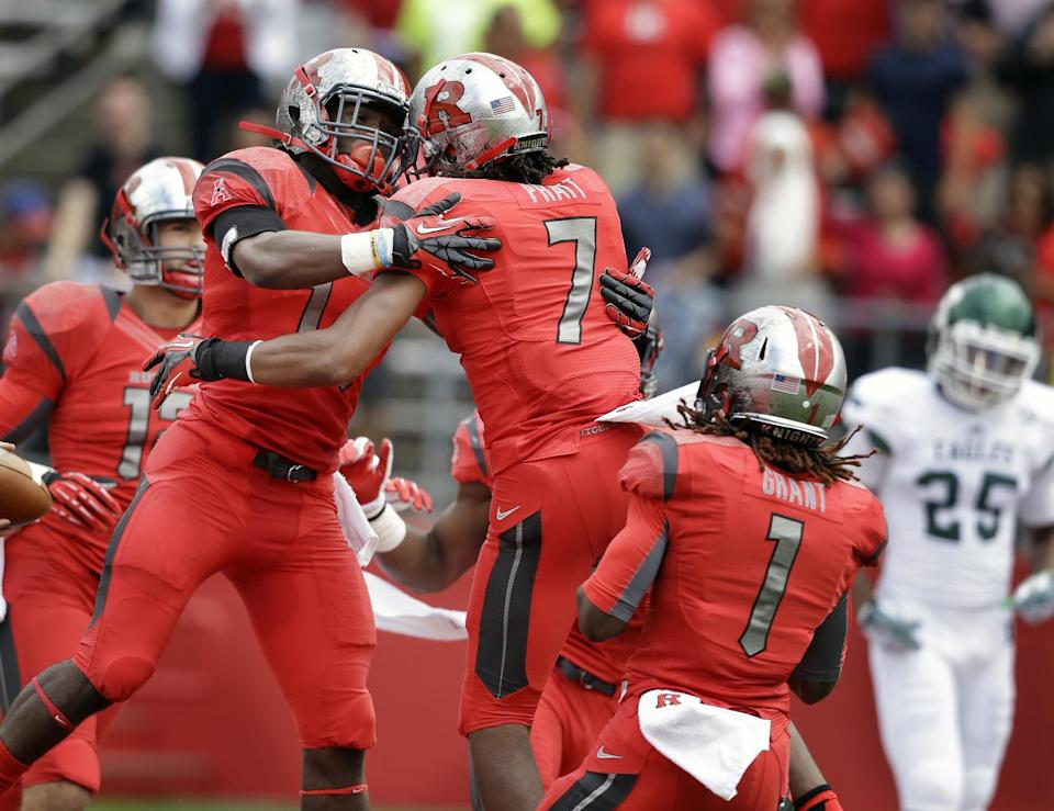 James rushes 3 TDS as Rutgers beats EMU 28-10