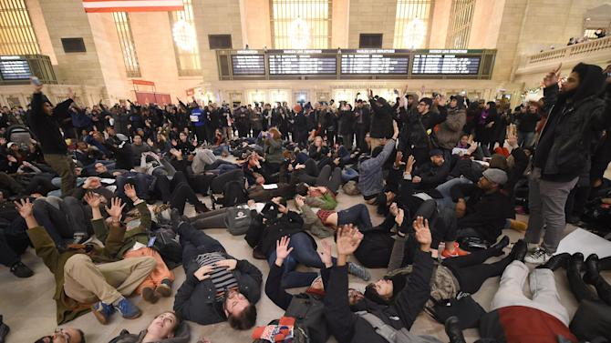 Protestors lie down in Grand Central Station during a protest on December 3, 2014 after a grand jury decided not to charge a white police officer in the choking death of a black man