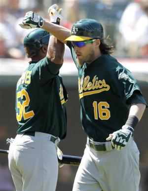 Athletics sweep Indians with 12-7 win