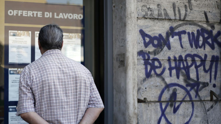 A man checks job offers displayed at a recruitment agency in Rome, Friday, Aug. 29, 2014. The Italian National Institute of Statistics (Istat) on Friday reported the unemployment rate for July 2014 at 12.6 percent, a rise of 0.3 percentage points over June. (AP Photo/Gregorio Borgia)
