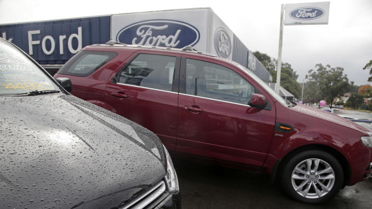 Rain falls on cars at a Ford dealership in Sydney on Thursday, May 23, 2013. Ford Motor Co. said it was closing its two Australian auto plants and ending production in the country in 2016, amid soaring manufacturing costs and plummeting sales. (AP Photo/Rick Rycroft)