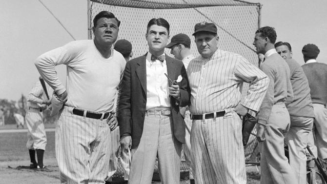 FILE - In this 1932 file photo, Associated Press sports writer Alan Gould is flanked by New York Yankees' Babe Ruth, left, and manager Joe McCarthy.  (AP Photo/File)