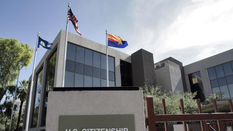 FILE – This Aug. 5, 2008, file photo, shows the U.S. Citizenship and Immigration Services building Phoenix. The Homeland Security Department expects applications for high-skilled immigration visas to outpace the available supply in a matter of days, one of the fastest runs on the much-sought-after work permits in years and a sign of continued economic recovery amid new hiring by U.S. technology companies. The urgent race for such visas _ highly desired by Microsoft, Apple, Google and other leading technology companies _ coincides with congressional plans to increase the number available to tech-savvy foreigners. (AP Photo/Matt York, File)