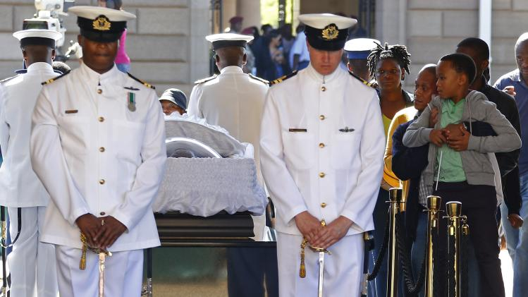 A boy looks at the coffin while paying his respects to former South African President Nelson Mandela, as Mandela lies in state at the Union Buildings in Pretoria