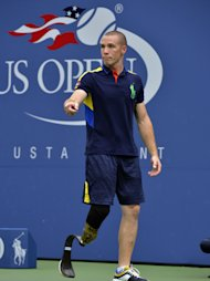 US Open ballperson Ryan McIntosh, who lost his leg serving in Afghanistan waits for the start of Serena Williams of the US  against Andrea Hlavackova of the Czech Republic during their 2012 US Open women's singles match at the USTA Billie Jean King National Tennis Center in New York on September 3, 2012. AFP PHOTO / TIMOTHY A. CLARYTIMOTHY A. CLARY/AFP/GettyImages