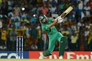 South African batsman Hashim Amla plays a shot during the ICC Twenty20 World Cup match between South Africa and Sri Lanka in Hambantota. South Africa beat hosts Sri Lanka by a convincing 32 run margin in a rain-shortened seven-over-a-side World Twenty20 group C match