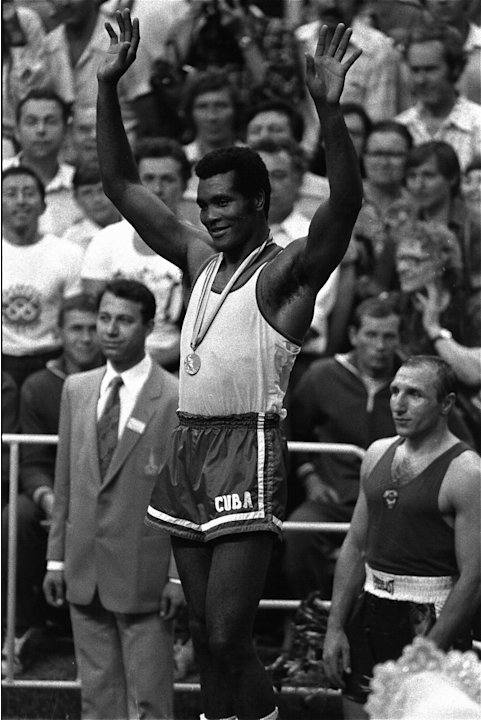 FILE - In this Aug. 2, 1980, file photo, after winning his third Olympic heavyweight championship gold medal, Cuba's Teofilo Stevenson waves to the crowd at the Moscow Olympic Games. Stevenson died on