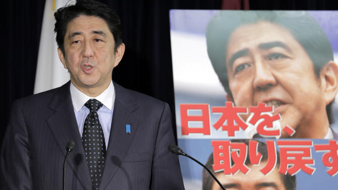"""Japan's largest opposition Liberal Democratic Party leader Shinzo Abe, standing by the party poster reading: """"We get back Japan,""""  speaks during a press conference in Tokyo, Friday, Nov. 16, 2012 after the lower house of parliament was dissolved. Prime Minister Yoshihiko Noda dissolved the lower house of parliament Friday, paving the way for elections in which his ruling party will likely give way to a weak coalition government divided over how to solve Japan's myriad problems. Abe, who had a one-year stint as prime minister in 2006 and 2007, now has a chance to return if the LDP wins the most seats in elections expected in mid December. (AP Photo/Koji Sasahara)     (AP Photo/Koji Sasahara)"""