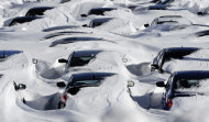 Snow begins to melt on cars parked at a dealership after a winter storm in Hartford, Conn., Sunday, Feb. 10, 2013. A howling storm across the Northeast left much of the New York-to-Boston corridor covered with more than three feet of snow on Friday into Saturday morning. (AP Photo/Jessica Hill)