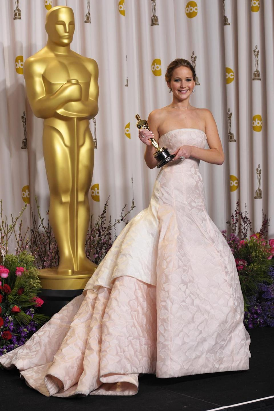 "Jennifer Lawrence poses with her award for best actress in a leading role for ""Silver Linings Playbook"" during the Oscars at the Dolby Theatre on Sunday Feb. 24, 2013, in Los Angeles. (Photo by John Shearer/Invision/AP)"