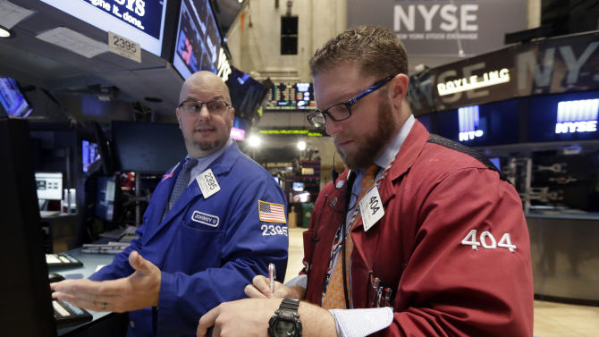 Specialist John Urbanowicz, left, and trader Ryan Falvey work on the floor of the New York Stock Exchange Wednesday, Oct. 22, 2014. Good news on corporate earnings nudged U.S. stocks higher Wednesday morning, a day after the Standard and Poor's 500 index had its best day of the year. (AP Photo/Richard Drew)