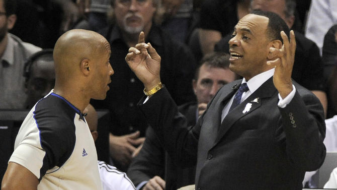 Memphis Grizzlies head coach Lionel Hollins, right, argues a call with referee Marc Davis during the first half of Game 1 of the Western Conference final NBA basketball playoff series against the San Antonio Spurs, Sunday, May 19, 2013, in San Antonio. (AP Photo/Darren Abate)