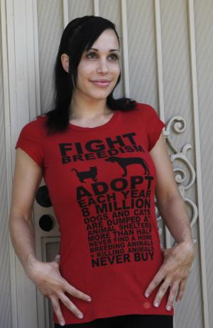 "FILE - In this file photo taken May 19, 2010, ""Octomom"" Nadya Suleman wears a t-shirt promoting pet birth control outside her home in La Habra, Calif.  Suleman has checked herself into a rehabilitation center, citing anxiety, exhaustion and stress. A statement from Suleman's spokeswoman Gina Rodriguez on Tuesday, Oct. 30, 2012 says the mother of 14 had been taking the medication Xanax under a doctor's care to deal with her problems. But Suleman felt she needed a treatment program to help with her recovery. (AP Photo/Damian Dovarganes, File)"