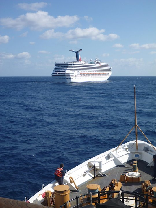 In this image released by the U.S. Coast Guard on Feb. 11, 2013, the Coast Guard Cutter Vigorous patrols near the cruise ship Carnival Triumph in the Gulf of Mexico, Feb. 11, 2013. The Carnival Triump