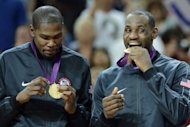 US gold medalists LeBron James and US forward Kevin Durant (L) pose on the podium after the London 2012 Olympic Games men&#39;s gold medal basketball game between USA and Spain at the North Greenwich Arena in London. The United States Dream Team of NBA stars captured their second successive Olympic men&#39;s basketball gold medal and the 14th overall for America by beating Spain 107-100