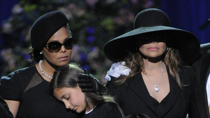 FILE - This July 7, 2009 file photo shows singer Janet Jackson, left, Paris Katherine Jackson, Prince Michael Jackson II, and LaToya Jackson on stage during the memorial service for Michael Jackson at the Staples Center in Los Angeles. Sony Electronics and the Nielsen television research company collaborated on a survey ranking TV's most memorable moments. Other TV events include, the Sept. 11 attacks in 2001, Hurricane Katrina in 2005, the O.J. Simpson murder trial verdict in 1995 and the death of Osama bin Laden in 2011. (AP Photo/Mark J. Terrill, Pool, File)