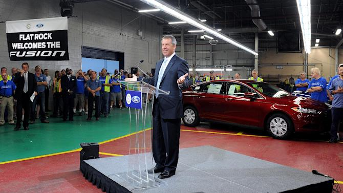 Joe Hinrichs, Ford president of the Americas, talks about the new 2014 Ford Fusion in Flatrock, Mich. on Thursday, Aug. 29, 2013. For the first time, Ford is making its Fusion sedan in the U.S. The company's Flat Rock, Mich., plant began making the Fusion on Thursday. (AP Photo/Detroit News, Charles V. Tines)
