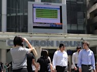 A stocks display board in the financial district of Raffles place in Singapore. In a statement posted on the Singapore Exchange website, F&N said it had &quot;reached a mutual agreement with Heineken to extend the deadline for acceptance of the Heineken offer by one week from 27 July 2012&quot;