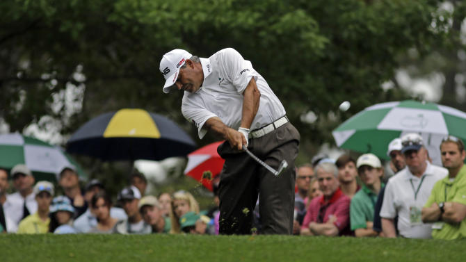 Angel Cabrera, of Argentina, tees off on the fourth hole during the fourth round of the Masters golf tournament Sunday, April 14, 2013, in Augusta, Ga. (AP Photo/Matt Slocum)