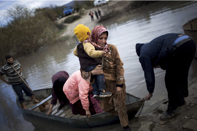 Syrian refugees cross from Syria to Turkey by the Orontes river, near the village of Hacipasa, Turkey, Saturday, Dec. 8, 2012.  Syrian rebel commanders have elected a new 30-member leadership council 