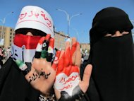 Two women hold up their hands painted with the Arabic writing: from one victory to another during a protest in Sanaa on January 27, 2012, to demand the arrest and trial of Yemen&#39;s veteran President Ali Abdullah Saleh