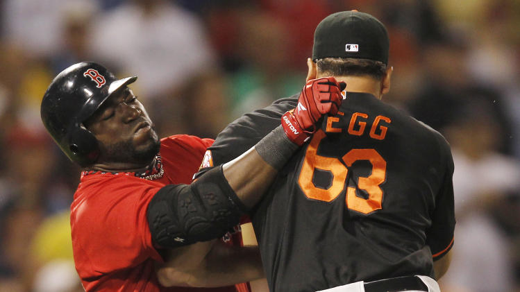 Baltimore Orioles relief pitcher Kevin Gregg (63) fights with Boston Red Sox designated hitter David Ortiz after they exchanged words after Ortiz flied out during the eighth inning of a baseball game at Fenway Park in Boston on Friday, July 8, 2011. (AP Photo/Winslow Townson)