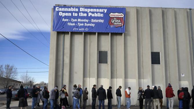 """Customers line up for """"Green Friday"""" deals at the Grass Station marijuana shop on Black Friday in Denver"""